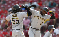 Pittsburgh Pirates' Josh Bell (55) celebrates a three-run home run off Cincinnati Reds relief pitcher Michael Lorenzen with Starling Marte (6) during the seventh inning of a baseball game, Wednesday, May 29, 2019, in Cincinnati. (AP Photo/Gary Landers)