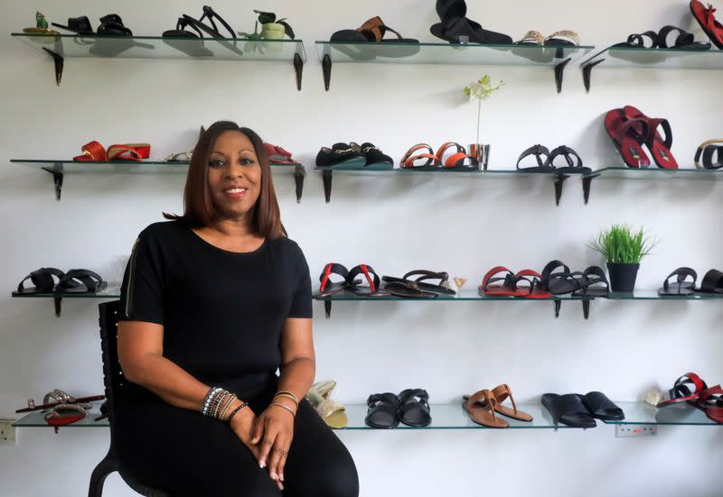Tokunbo Onagoruwa, Chief Executive Officer of City Cobbler, poses for a picture in her store in Lagos