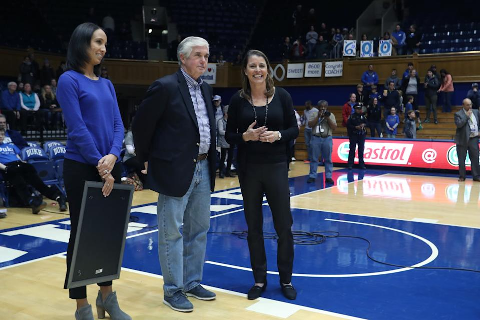 DURHAM, NC - DECEMBER 29: Duke head coach Joanne P. McCallie (right), with athletic director Kevin White and Deputy Director of Athletics Nina King, is honored after winning her 600th game as a head coach during the Duke Blue Devils game versus the Liberty Flames on December 29, 2017, at Cameron Indoor Stadium in Durham, NC. (Photo by Andy Mead/YCJ/Icon Sportswire via Getty Images)
