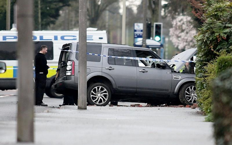 A suspect was arrested after crashing a Land Rover near the scene - Credit: SWNS
