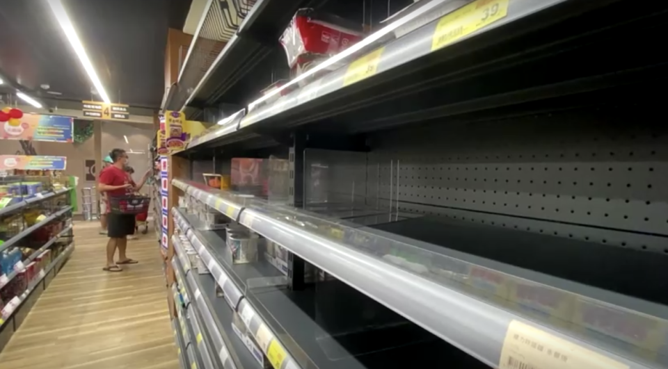 Supermarket shelves were stripped of noodles as residents feared greater restrictions. Source: Reuters