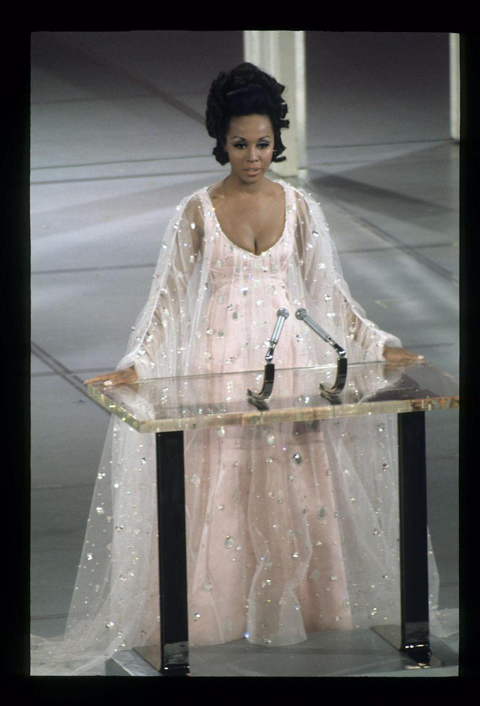 <p>Just look at those epic sleeves! Diahann was positively angelic in this pale pink tulle gown with sparkly embellishments throughout. She was one of the presenters on stage during the ceremony.</p>