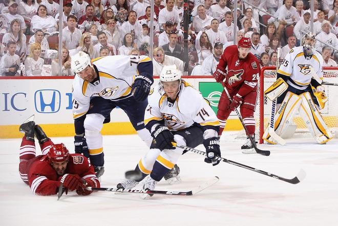 GLENDALE, AZ - APRIL 27:  Sergei Kostitsyn #74 and Hal Gill #75 of the Nashville Predators clear the puck away from Boyd Gordon #15 of the Phoenix Coyotes in the second period of Game One of the Western Conference Semifinals during the 2012 NHL Stanley Cup Playoffs at Jobing.com Arena on April 27, 2012 in Glendale, Arizona.  (Photo by Christian Petersen/Getty Images)