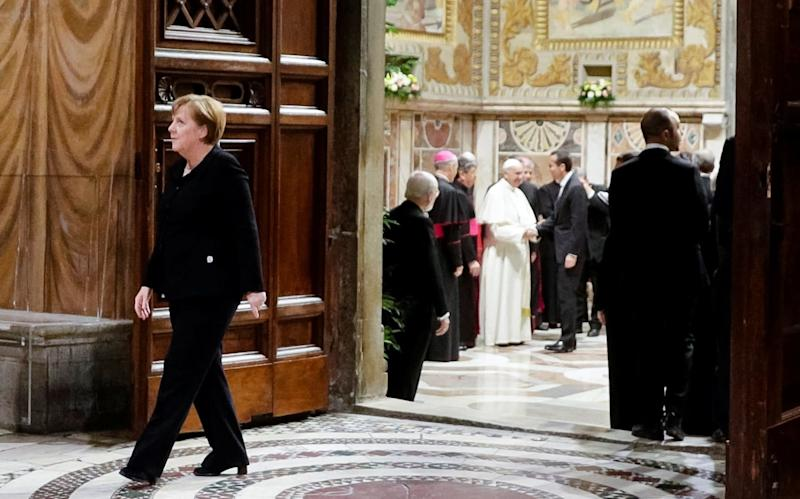 Merkel leaves a meeting with the Pope on Friday - REUTERS