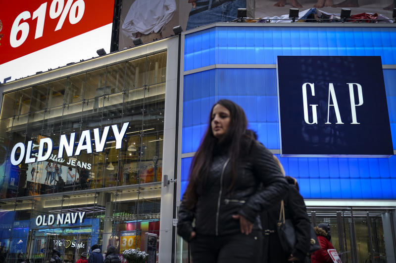 NEW YORK, NY - MARCH 01: Pedestrians walk past Old Navy and GAP stores in Times Square, March 1, 2019 in New York City. On Thursday, Gap Inc. announced plans to separate into two publicly traded companies, spinning off Old Navy into a separate firm as it closes about 230 Gap stores over the next two years. According to Gap Inc., Old Navy will become its own company, and the other company, which has not been named yet, will consist of the Gap brand, Athleta, Banana Republic, Intermix and Hill City. (Photo by Drew Angerer/Getty Images)