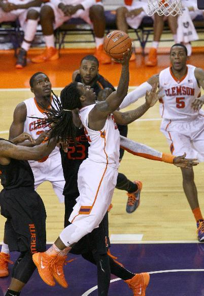 Clemson's Rod Hall scores against Miami during the second half of the NCAA Men's basketball game at Littlejohn Coliseum Tuesday, March 4, 2014, in Clemson, S.C.. (AP Photo/The Independent-Mail, Ken Ruinard)