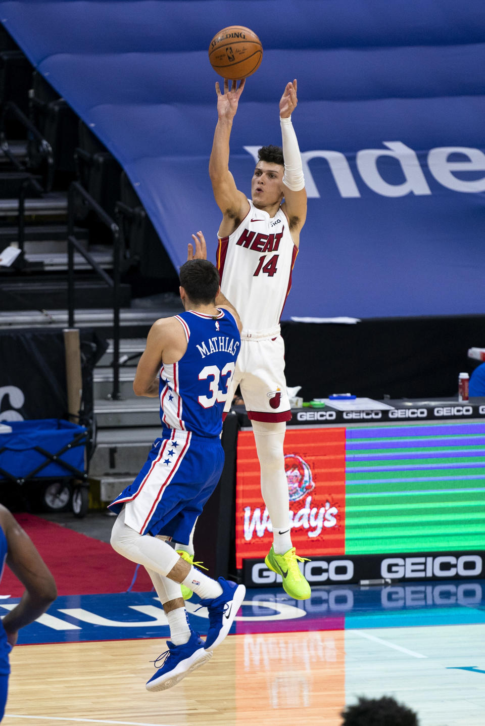 Miami Heat's Tyler Herro, right, releases a 3-point shot over Philadelphia 76ers' Dakota Mathias, left, during overtime of an NBA basketball game Tuesday, Jan. 12, 2021, in Philadelphia. (AP Photo/Chris Szagola)