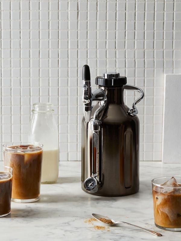 "The nitro-brew lover can save some coins and make it at home thanks to this GrowlerWerks coffee maker—complete with a patented nitro system that delivers the same creamy goodness as their local cafe. $199, Food52. <a href=""https://food52.com/shop/products/6683-growlerwerks-ukeg-nitro-cold-brew-coffee-maker"" rel=""nofollow noopener"" target=""_blank"" data-ylk=""slk:Get it now!"" class=""link rapid-noclick-resp"">Get it now!</a>"