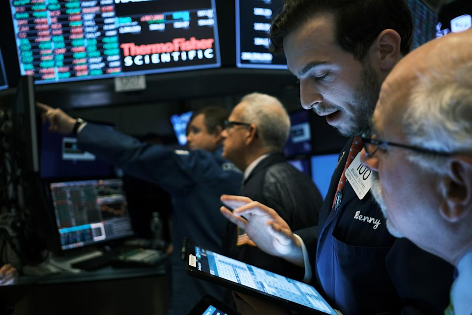 NEW YORK, NEW YORK - NOVEMBER 20: Traders work on the floor of the New York Stock Exchange (NYSE) on November 20, 2019 in New York City. As trade talks with China continue to lack resolution, frustrating investors, the Dow Jones Industrial Average ended the day down over 100 points. (Photo by Spencer Platt/Getty Images)