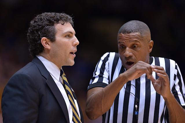 Referee Ted Valentine talks with Georgia Tech's Josh Pastner during the game against Duke earlier this season. (Getty)