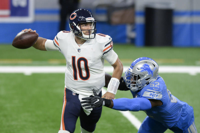 Chicago Bears quarterback Mitchell Trubisky (10) throws under pressure from Detroit Lions outside linebacker Christian Jones (52) in the first half of an NFL football game against the in Detroit, Sunday, Sept. 13, 2020. (AP Photo/Jose Juarez)