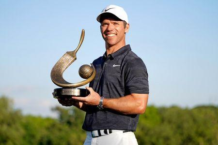 Mar 24, 2019; Palm Harbor, FL, USA; Paul Casey holds the winners trophy after winning the Valspar Championship golf tournament at Innisbrook Resort - Copperhead Course. Mandatory Credit: Jasen Vinlove-USA TODAY Sports