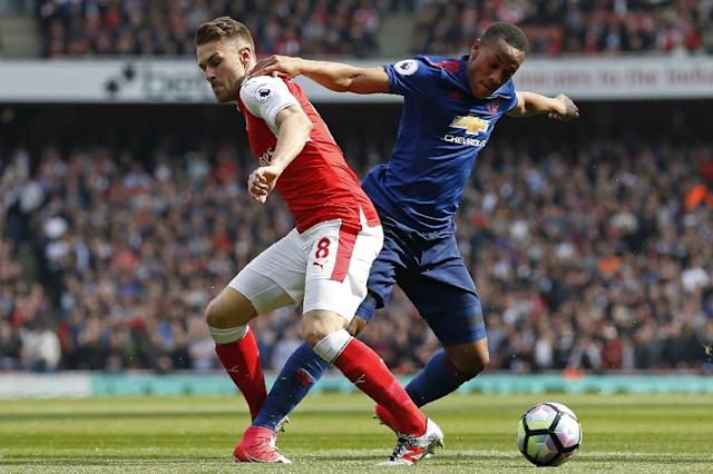 Manchester United's striker Anthony Martial (R) vies with Arsenal's midfielder Aaron Ramsey during the English Premier League football match between Arsenal and Manchester United at the Emirates Stadium in London on May 7, 2017 (AFP Photo/Ian KINGTON)