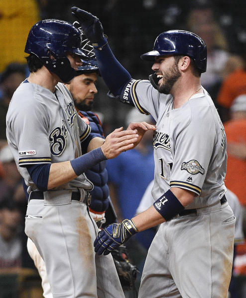 Milwaukee Brewers' Mike Moustakas, right, celebrates his two-run home run off Houston Astros relief pitcher Cionel Perez with Christian Yelich during the 14th inning of a baseball game Wednesday, June 12, 2019, in Houston. (AP Photo/Eric Christian Smith)