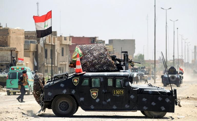 An Iraqi federal police humvee parked on a road during the advance towards the Old City of Mosul on June 19, 2017 as the ongoing offensive continues to retake the last district still held by the Islamic State (IS) group fighters