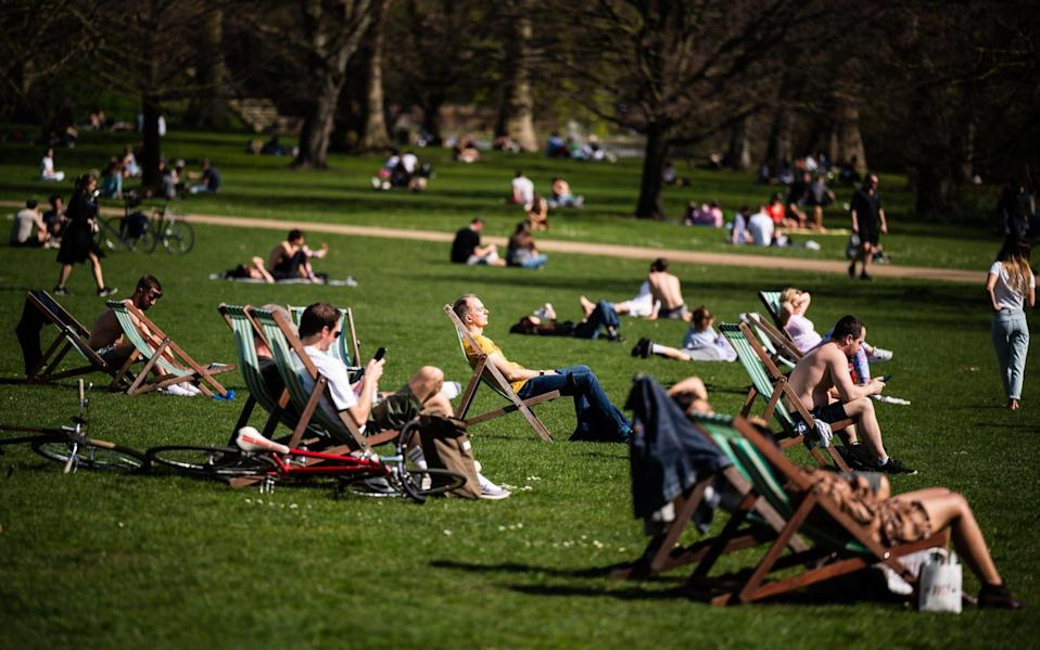 People sunbathing in St James's Park in London on March 30 as the temperature hits 24C - Leon Neal/Getty