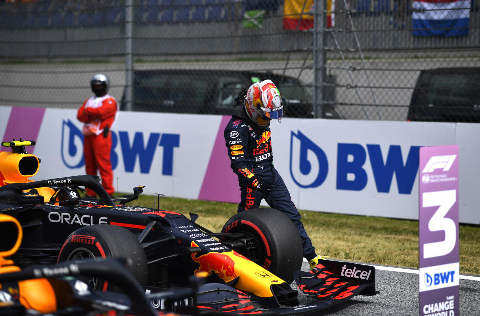 Red Bull driver Sergio Perez of Mexico gets out of his car after placing third during the qualifying session ahead of the Austrian Formula One Grand Prix at the Red Bull Ring racetrack in Spielberg, Austria, Saturday, July 3, 2021. The Austrian Grand Prix will be held on Sunday. (Christian Bruna/Pool Photo via AP)