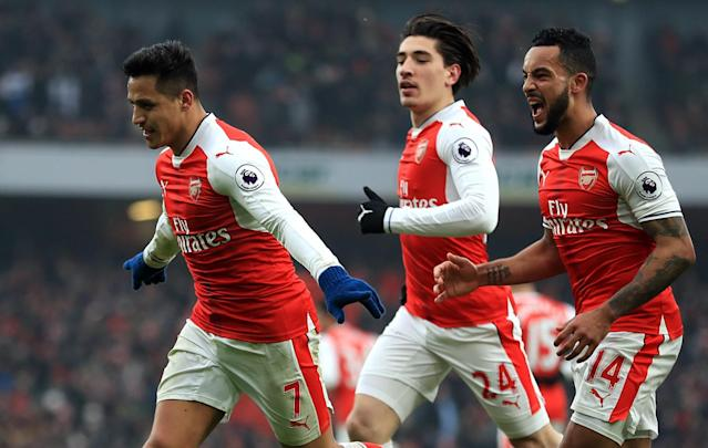 <p>Alexis Sanchez leads the celebrations after putting Arsenal in front</p>