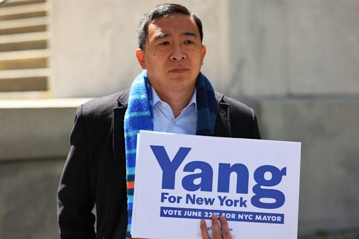 NYC mayoral candidate Andrew Yang holds a campaign sign at a press conference at Tweed Courthouse in Manhattan on May 11, 2021 in New York City. Yang was joined by a parent of public school children at a press conference where he called for full-time, in-person learning in classrooms for all students and teachers by the start of the next school year in September. (Photo by Michael M. Santiago/Getty Images)