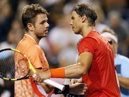Aug 9, 2018; Toronto, Ontario, Canada; Stan Wawrinka (left) and Rafael Nadal (right) meet at center court following their match in the Rogers Cup tennis tournament at Aviva Centre. John E. Sokolowski-USA TODAY Sports