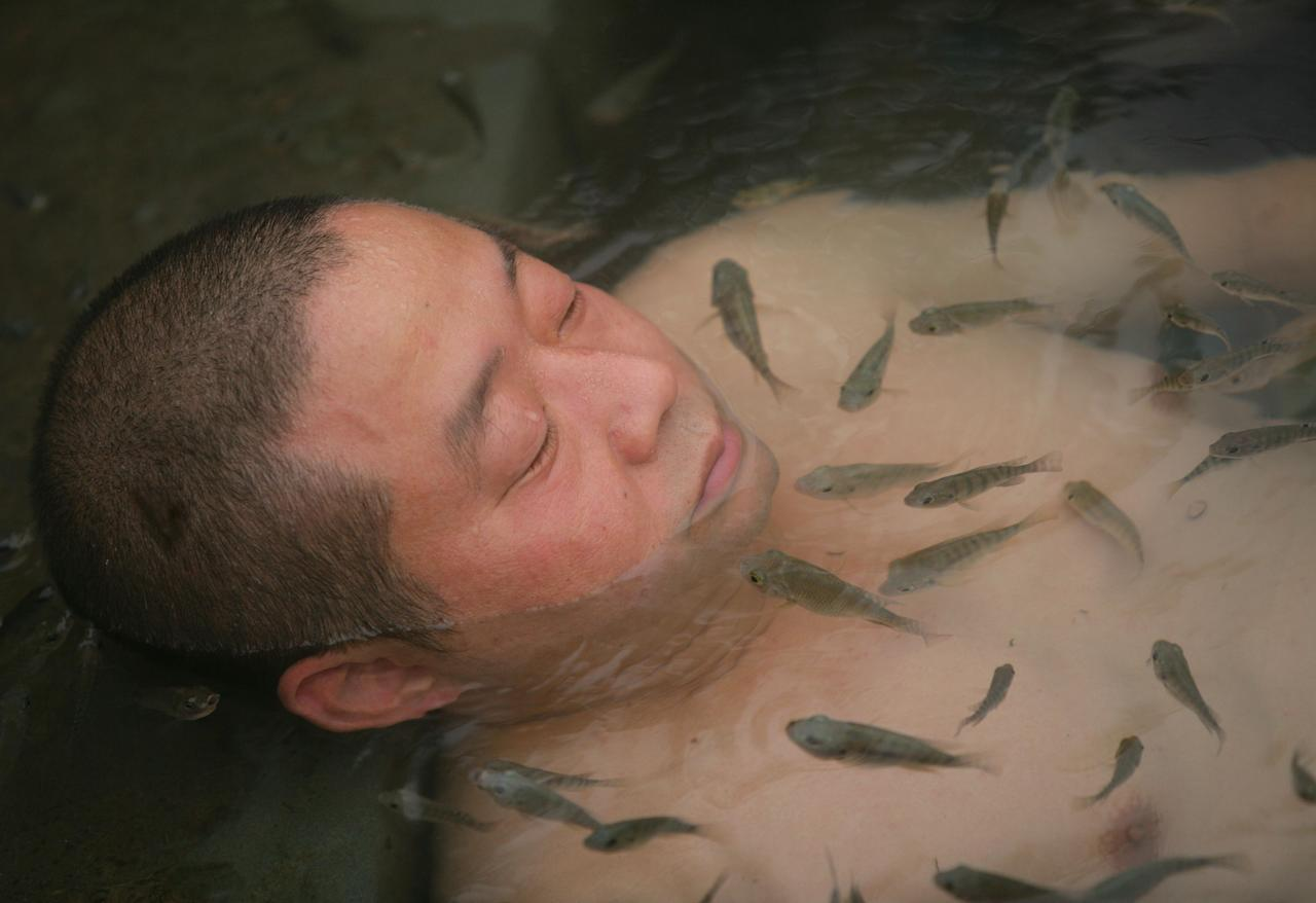 "<div class=""caption-credit""> Photo by: Getty Images</div><div class=""caption-title"">Fish bath</div>Back in China, they don't stop at the feet. At Dr. Fish, a hot spring resort in the Chongqing Municipality, spa-goers soak their entire bodies in freshwater fish baths. Their exfoliating effects (gnawing off dead skin with abandon) leave patrons with what's been described as a ""healthy glow."" <br>"