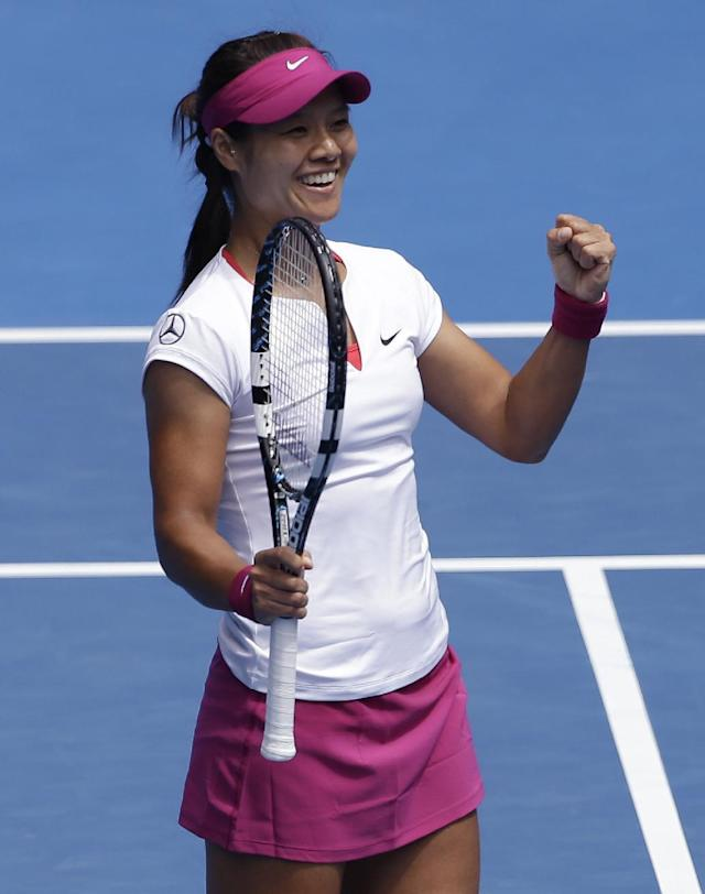 Li Na of China celebrates after defeating Flavia Pennetta of Italy during their quarterfinal at the Australian Open tennis championship in Melbourne, Australia, Tuesday, Jan. 21, 2014.(AP Photo/Aijaz Rahi)