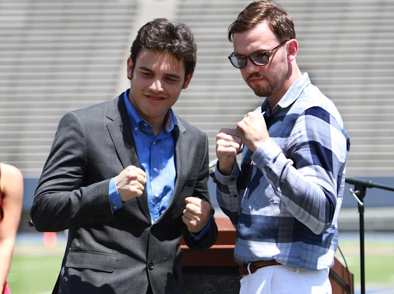 FILE - In this April 24, 2012 file photo, Julio Cesar Chavez Jr., left, and his opponent Andy Lee pose for pictures during a news conference at the Sun Bowl in El Paso, Texas. With controversy still swirling around Manny Pacquiao's decision loss to Timothy Bradley over the weekend, Chavez Jr. prepares for his title fight against Lee on Saturday night, June 16, 2012, in El Paso, Texas, with the grim specter of Mexico's drug wars casting a shadow from just across the border. (AP Photo/El Paso Times, Rudy Guteirrez) EL DIARIO OUT EL DIARIO DE EL PASO OUT