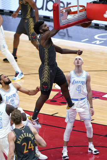 Chicago Bulls forward Patrick Williams dunks against the Los Angeles Lakers during the first half of an NBA basketball game in Chicago, Saturday, Jan. 23, 2021. (AP Photo/Nam Y. Huh)