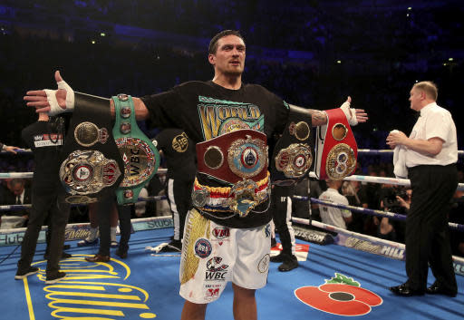 Oleksandr Usyk celebrates his victory against Tony Bellew in their cruiserweight boxing bout Saturday, Nov. 10, 2018, in Manchester, England. Usyk successfully defended his four belts and likely sent Bellew into retirement by knocking out the British fighter in the eighth round. (Nick Potts/PA via AP)