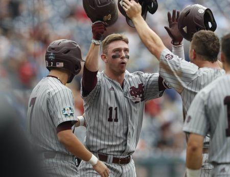 Jun 19, 2018; Omaha, NE, USA; Mississippi State Bulldogs designated hitter Jordan Westburg (11) celebrates after hitting a grand slam home run against North Carolina Tar Heels in the second inning in the College World Series at TD Ameritrade Park. Mandatory Credit: Bruce Thorson-USA TODAY Sports