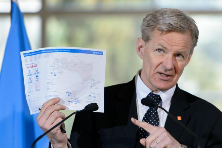 Jan Egeland, special advisor to the UN Syria envoy, holds a document related to UN aid convoys in Syria during a press conference following a new round of peace talks on Syria at the United Nations Offices in Geneva on March 23, 2016