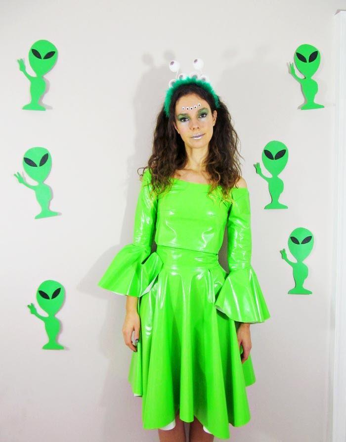 """<p>Who says aliens can't be stylish? Make your own googly-eyed headband and green vinyl dress (or substitute a store-bought dress, or wear neon green leggings and tee) to create this elegant version of an alien visitor. </p><p><strong>Get the tutorial at  <a href=""""http://www.jessthetics.com/2014/10/diy-alien-costume-part-1/"""" target=""""_blank"""">Jessthetics</a>.</strong></p><p><a class=""""body-btn-link"""" href=""""https://www.amazon.com/Hanes-Womens-Performance-V-Neck-X-Large/dp/B00KRYPMNO/ref=sr_1_6?keywords=neon+green+tshirt&qid=1563995169&s=gateway&sr=8-6&tag=syn-yahoo-20&ascsubtag=%5Bartid%7C10050.g.28496790%5Bsrc%7Cyahoo-us"""" target=""""_blank"""">SHOP NEON TEES</a> </p>"""