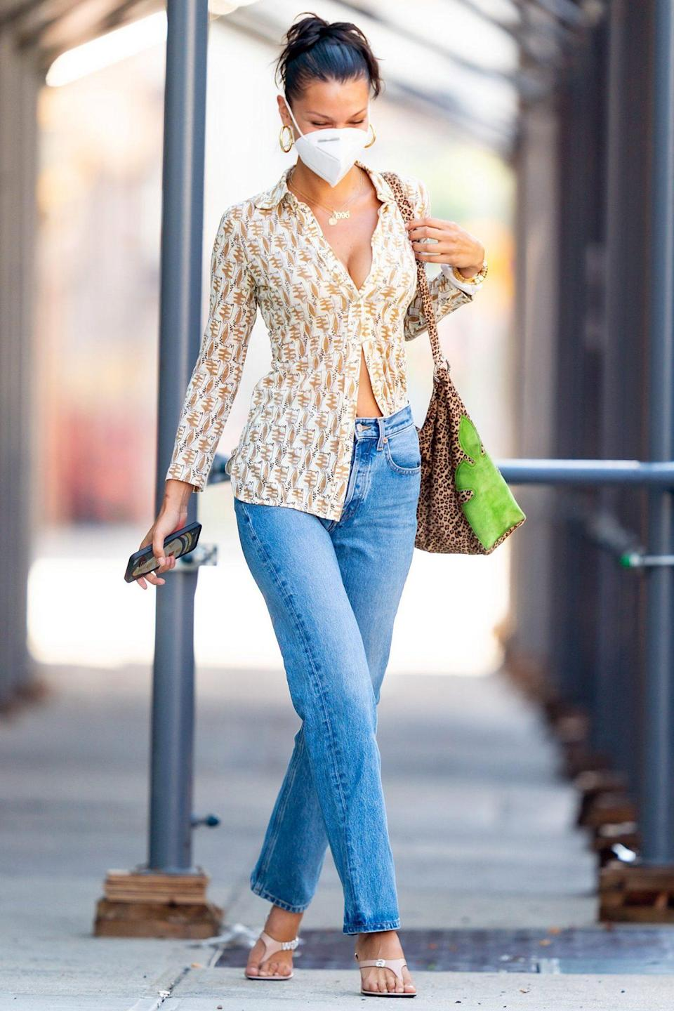 <p>Bella Hadid steps out in N.Y.C. in style on Monday, wearing a chic blouse, jeans and sandals.</p>