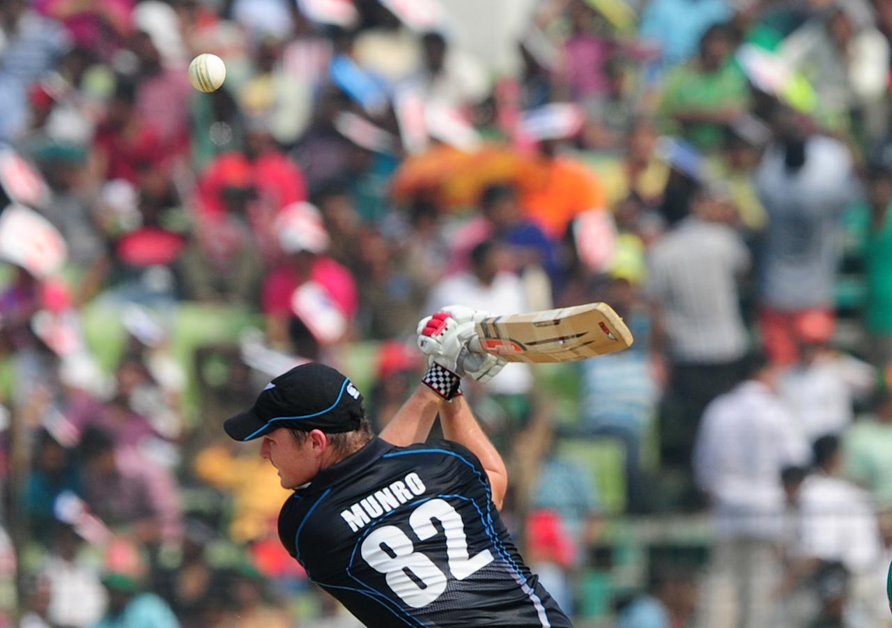 New Zealand batsman Colin Munro plays a shot during the third One-Day International (ODI) cricket match between Bangladesh and New Zealand at Khan Jahan Ali Stadium in Fatullah, on the outskirts of Dhaka on November 3, 2013.  AFP PHOTO/ Munir uz ZAMAN        (Photo credit should read MUNIR UZ ZAMAN/AFP/Getty Images)