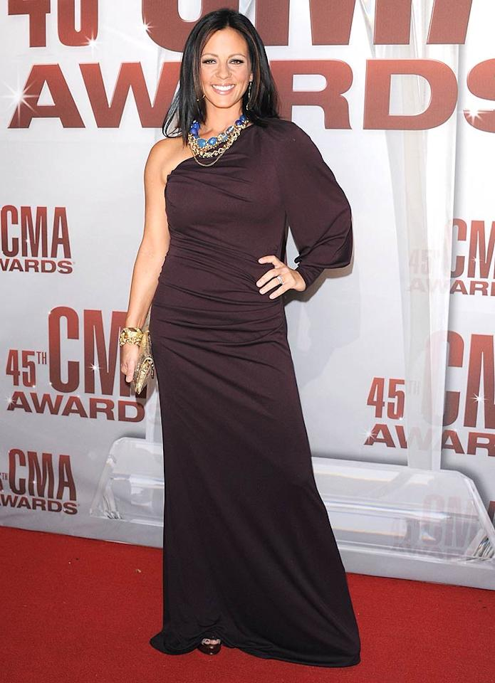 Songstress Sara Evans -- who was nominated for both Single of the Year and Female Vocalist of the Year -- looked confident as she strolled in. But her unflattering  frock didn't win her any fashion awards! (11/9/2011)