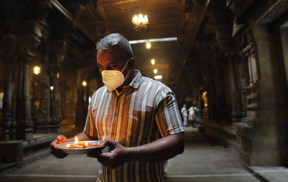 A Sri Lankan ethnic Tamil Hindu devotee performs religious rituals at a temple on New Year's day in Colombo, Sri Lanka, Friday, Jan. 1, 2021. (AP Photo/Eranga Jayawardena)
