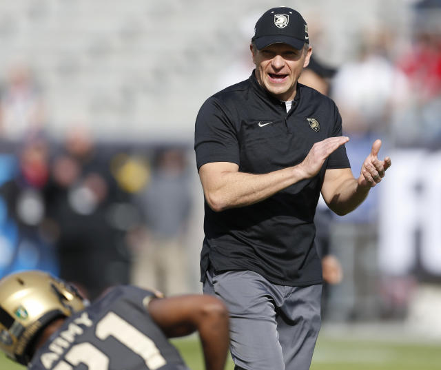 FILE - In this Dec. 22, 2018, file photo, Army head coach Jeff Monken watches as his team warms up before they play Houston in the of Armed Forces Bowl NCAA college football game, in Fort Worth, Texas. Coach Monken finished last season in rarefied air with a school-record 11 wins. Maintaining that standard of excellence is the goal.(AP Photo/Jim Cowsert, File)