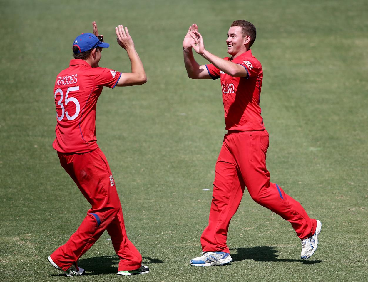 DUBAI, UNITED ARAB EMIRATES - FEBRUARY 22:  Ryan Higginns of England celebrates with William Rhodes during the ICC U19 Cricket World Cup 2014 Quarter Final match between England and India at the Dubai Sports City Cricket Stadium on February 22, 2014 in Dubai, United Arab Emirates.  (Photo by Francois Nel - IDI/IDI via Getty Images)