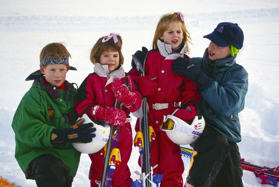 KLOSTERS, SWITZERLAND - JANUARY 03:  Klosters, Switzerland --- Prince William Helping His Cousin Princess Beatrice With The Collar Of Her Ski Suit As They Pose With Prince Harry And Princess Eugenie For A Photocall During Their Skiing Holiday.  (Photo by Tim Graham Photo Library via Getty Images)