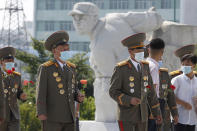 Korean People's Army officers visit the Fatherland Liberation War Martyrs Cemetery in Pyongyang, North Korea, Tuesday, July 27, 2021 to mark the Korean War armistice anniversary. The leaders of North and South Korea restored suspended communication channels between them and agreed to improve ties, both governments said Tuesday, amid a 2 ½ year-stalemate in U.S.-led diplomacy aimed at stripping North Korea of its nuclear weapons. (AP Photo/Cha Song Ho)