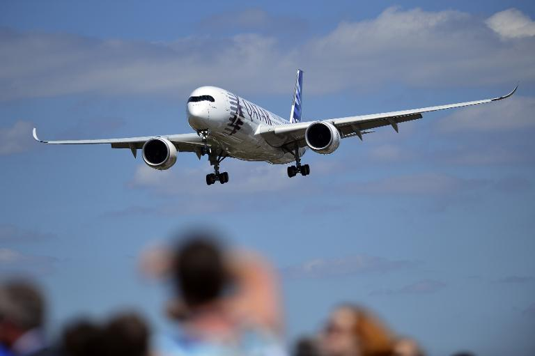 An Airbus A350-900, part of the company's new A350 XWB family of aircraft, gives a flight demonstration at the Farnborough Air Show on July 14, 2014