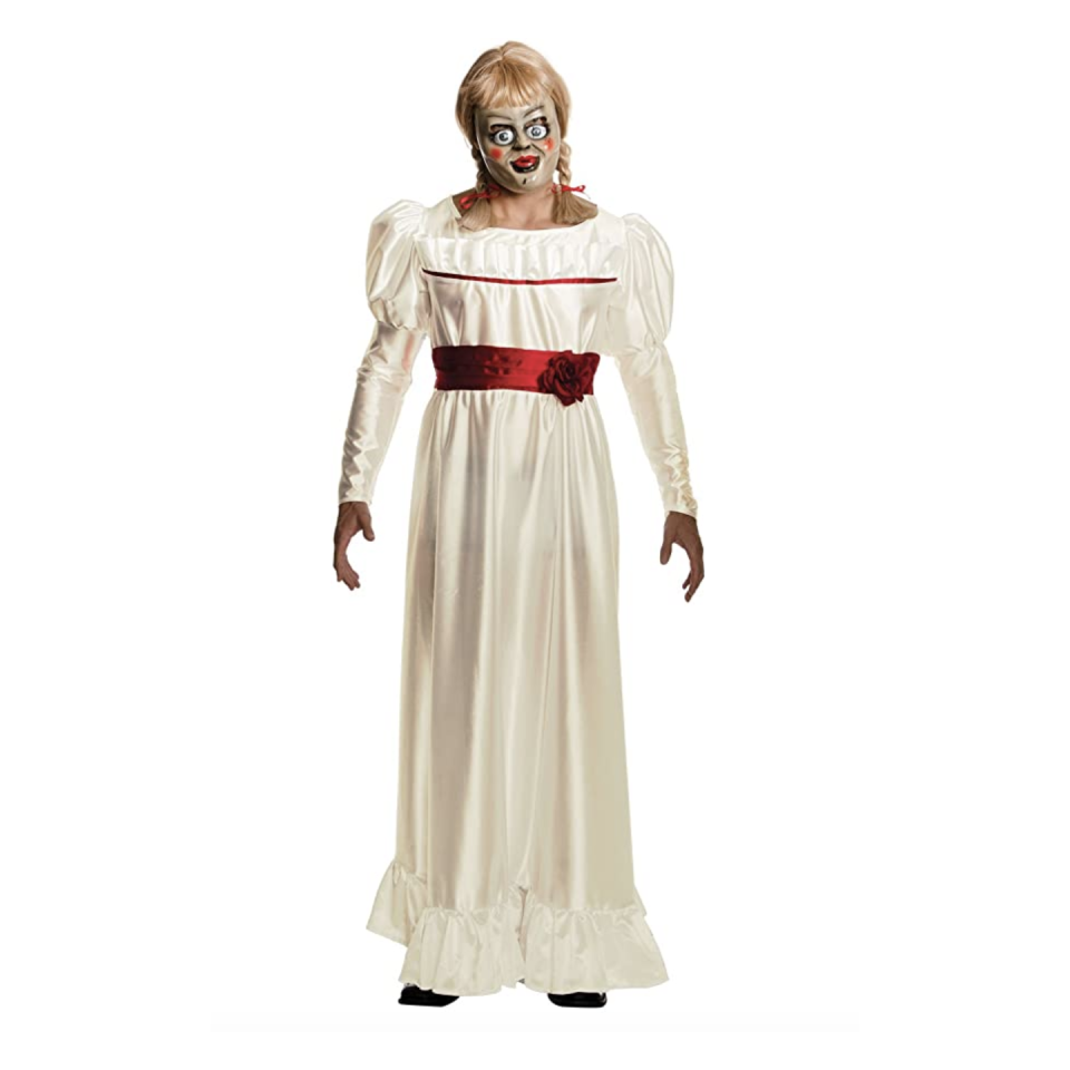 "<p><strong>Rubie's</strong></p><p>amazon.com</p><p><strong>$14.87</strong></p><p><a href=""https://www.amazon.com/Rubies-Annabelle-Horror-Costume/dp/B00UAD5P7A?tag=syn-yahoo-20&ascsubtag=%5Bartid%7C10055.g.4564%5Bsrc%7Cyahoo-us"" rel=""nofollow noopener"" target=""_blank"" data-ylk=""slk:Shop Now"" class=""link rapid-noclick-resp"">Shop Now</a></p><p> It's a one-size fits all look, so anyone can try to replicate the possessed doll. Just look at those eyebrows! The set includes a dress, wig, and mask.</p><p><strong>RELATED:</strong> <a href=""https://www.goodhousekeeping.com/holidays/halloween-ideas/g28102891/badass-halloween-costumes-women/"" rel=""nofollow noopener"" target=""_blank"" data-ylk=""slk:33 Totally Badass Halloween Costumes for Your Most Empowering Year Yet"" class=""link rapid-noclick-resp"">33 Totally Badass Halloween Costumes for Your Most Empowering Year Yet</a></p>"