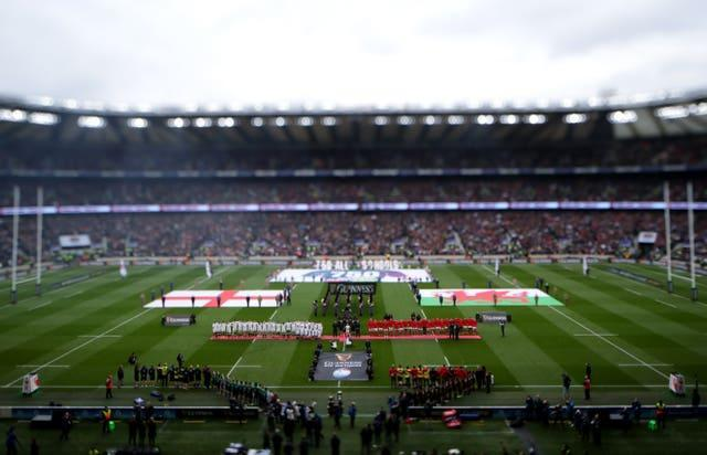 Both teams line-up for the national anthem before a Guinness Six Nations match at Twickenham