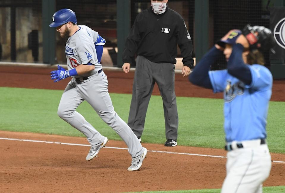 Max Muncy rounds the bases after his fifth-inning solo home run off Rays pitcher Tyler Glasnow.