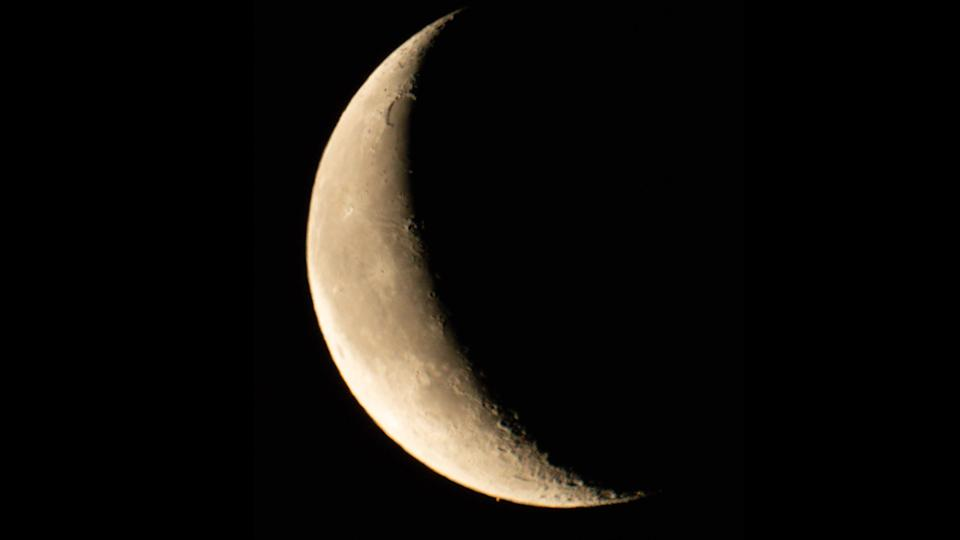 Astrophotographer B.G. Boyd captured this view of the crescent moon making its way toward Mars in the early morning sky over Tucson, Arizona, shortly before the occultation began on Feb. 18, 2020.