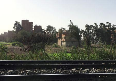 Houses are seen behind train tracks at the village of Ikyad Dijwi in the Nile Delta of El Qanater El Khayreya city in Al Qalyubia Governorate, Egypt, October 30, 2018. Picture taken  October 30, 2018. REUTERS/Lena Masri