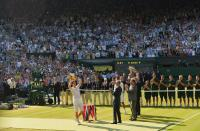 Andy Murray of Britain holds the winners trophy after defeating Novak Djokovic of Serbia in their men's singles final tennis match at the Wimbledon Tennis Championships, in London