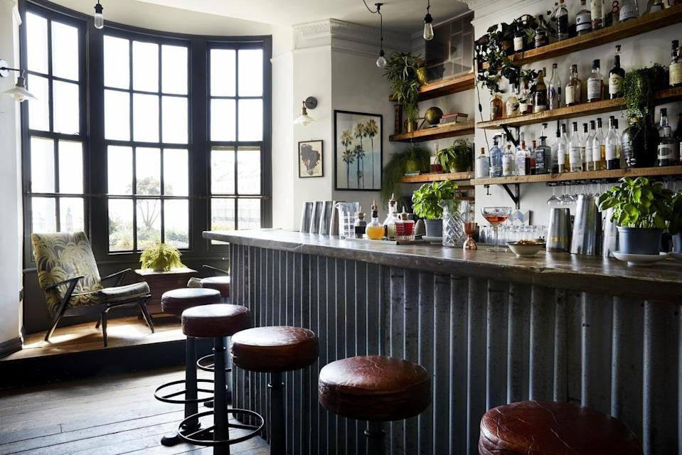 """<p>Enjoy the city life with a dash of salty sea air, ocean views and a cool local crowd at this stylish boutique hotel outside London.</p><p>Modern rustic meets industrial interiors (think wood feature walls, pendant lights, exposed brick), and contemporary art adds further life to the space. The beach is just a few steps away, while there's artisanal shops and cobbled street charm at the fashionable Lanes area just 10 minutes down the road. A trendy escape to dust off the cobwebs!</p><p><strong>Distance from London by train:</strong> London Victoria and London Bridge to Brighton takes around 1 hour.</p><p><a href=""""https://www.redescapes.com/offers/east-sussex-brighton-artist-residence-hotel"""" rel=""""nofollow noopener"""" target=""""_blank"""" data-ylk=""""slk:Read our review of Artist Residence"""" class=""""link rapid-noclick-resp"""">Read our review of Artist Residence</a></p><p><a class=""""link rapid-noclick-resp"""" href=""""https://go.redirectingat.com?id=127X1599956&url=https%3A%2F%2Fwww.booking.com%2Fhotel%2Fgb%2Fartists-residence.en-gb.html%3Faid%3D2070929%26label%3Dhotels-outside-london&sref=https%3A%2F%2Fwww.redonline.co.uk%2Ftravel%2Finspiration%2Fg34469437%2Fhotels-outside-london%2F"""" rel=""""nofollow noopener"""" target=""""_blank"""" data-ylk=""""slk:CHECK AVAILABILITY"""">CHECK AVAILABILITY</a></p>"""