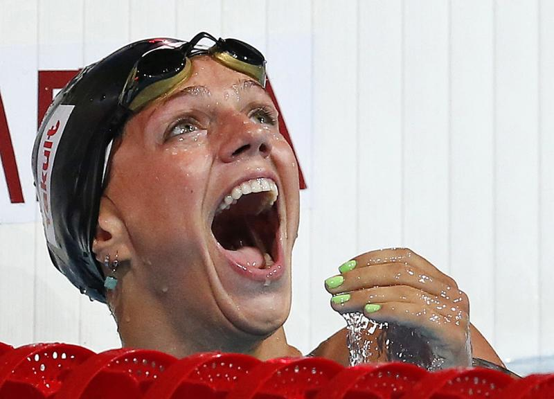 Russia's Yuliya Efimova celebrates after winning her Women's 50m breaststroke heat in a new world record time of 29.78 at the FINA Swimming World Championships in Barcelona, Spain, Saturday, Aug. 3, 2013. (AP Photo/Michael Sohn)