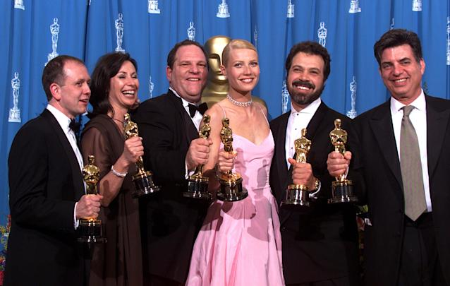 """Harvey Weinstein and Gwyneth Paltrow celebrated at the Oscars in1999, when """"Shakespeare in Love"""" tookBest Picture and Paltrow took Best Actress. (Bob Riha Jr. via Getty Images)"""